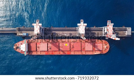 Bulk carrier docked in a Mediterranean port - Top down aerial view