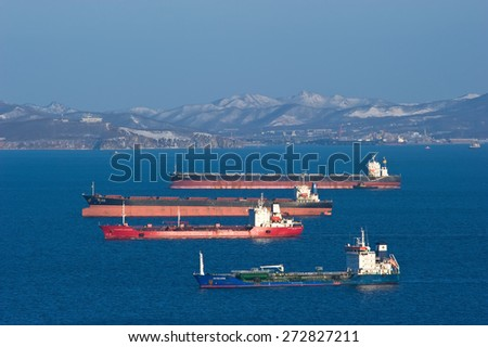 Bulk carrier Mineral Haiku, bulk carrier Twin Dragon, tanker Vladimir Vysotsky and tanker RN Polaris anchored in the roads. Nakhodka Bay. East (Japan) Sea. 05.03.2015