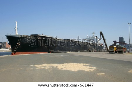 Bulk carrier vessel loading grains directly from trucks.