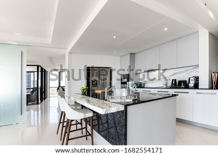 Bulk head inside a modern kitchen with stone bench