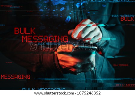 Bulk messaging concept. Sending large numbers of SMS messages with smartphine app. Low key red and blue lit image and digital glitch effect