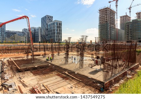 bulk pile driving. pile driving machine in construction site. Workers are managing pile driving machines in construction site.  #1437549275