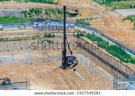 bulk pile driving. pile driving machine in construction site. Workers are managing pile driving machines in construction site.  #1437549281