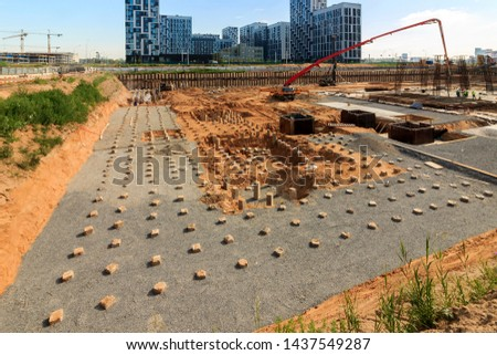 bulk pile driving. pile driving machine in construction site. Workers are managing pile driving machines in construction site.  #1437549287