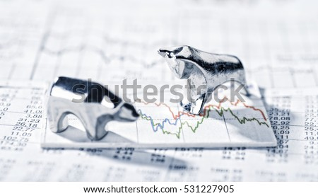 Bull and Bear are on a graphic with market prices. #531227905
