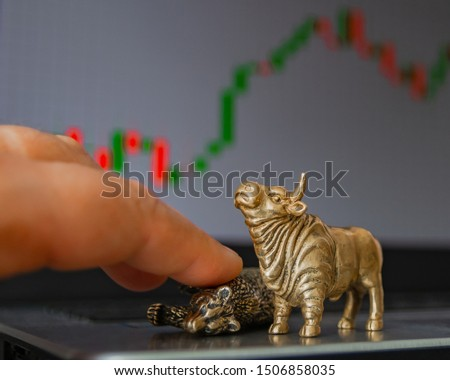 Bull and bear as symbols of stock trading on a blurred background of price graphics. The concept of symbolism of commodity and financial world markets. #1506858035