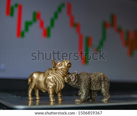 Bull and bear as symbols of stock trading on a blurred background of price graphics. The concept of symbolism of commodity and financial world markets. #1506859367