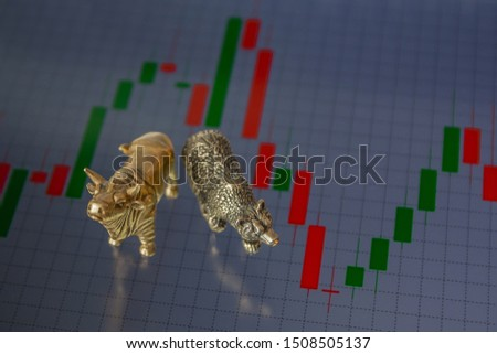 Bull and bear as symbols of stock trading on a blurred background of price graphics. The concept of symbolism of commodity and financial world markets. #1508505137