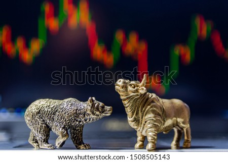Bull and bear as symbols of stock trading on a blurred background of price graphics. The concept of symbolism of commodity and financial world markets. #1508505143