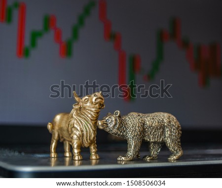 Bull and bear as symbols of stock trading on a blurred background of price graphics. The concept of symbolism of commodity and financial world markets. #1508506034