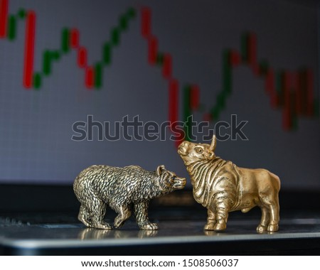 Bull and bear as symbols of stock trading on a blurred background of price graphics. The concept of symbolism of commodity and financial world markets. #1508506037