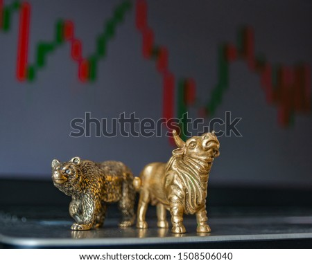Bull and bear as symbols of stock trading on a blurred background of price graphics. The concept of symbolism of commodity and financial world markets. #1508506040