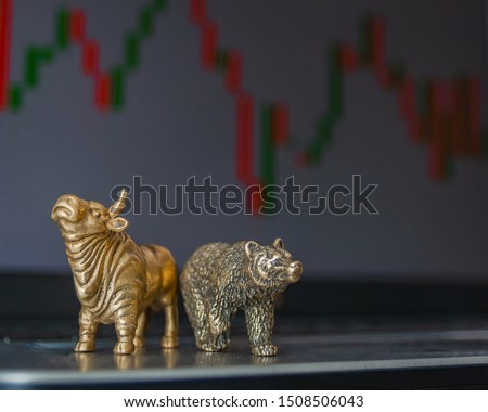 Bull and bear as symbols of stock trading on a blurred background of price graphics. The concept of symbolism of commodity and financial world markets. #1508506043