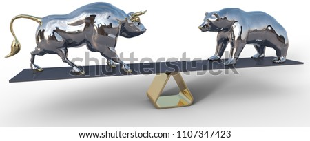 bull and bear stock market symbols balance on business investing scale