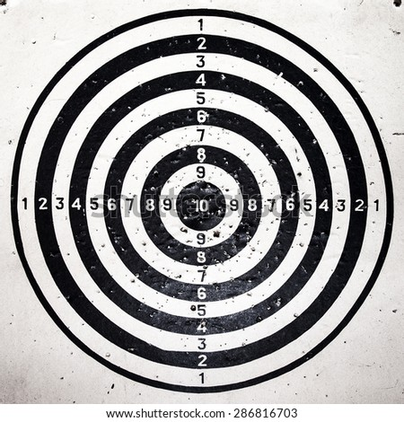 Bull eye target with bullets holes