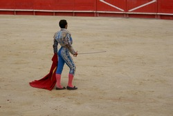 Bull fighter in full costume showing himself to the audience in the arena-Spain