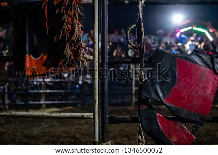 bull riding gear on gate in Guatemalan rodeo
