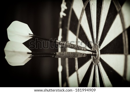 Bull\'s-Eye ! / Vintage style photo from three darts hit the double Bull\'s-Eye
