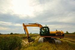 bulldozer at work in the summer