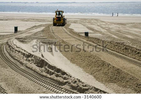 bulldozer at work on the beach