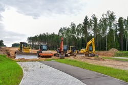 Bulldozer, Excavator and Soil compactor on road work. Earth-moving heavy equipment and Construction machinery  during land clearing, grading, pool excavation, utility trenching and digging