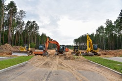 Bulldozer, Excavator and Soil compactor on road work. Earth-moving heavy equipment and Construction machinery  during road construction. Soft focus