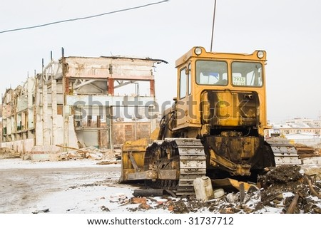 Bulldozer in front of old building for destruction