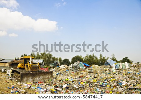 Bulldozer in the middle of garbage dump