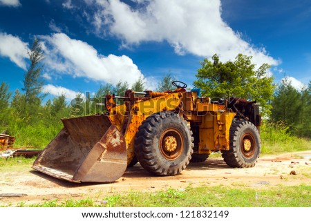 Bulldozer in tropical jungle, Thailand