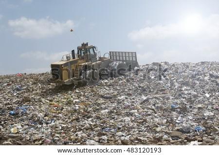 Bulldozer on rubbish tip