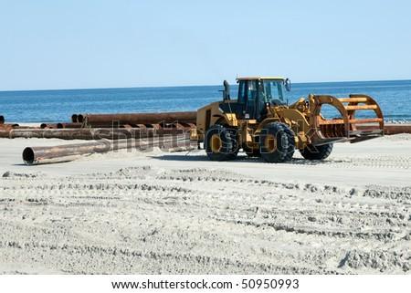 Bulldozer pulling Pipe #50950993