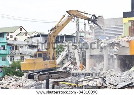 Bulldozer vehicle destroy old construction
