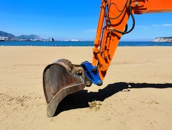 bulldozer working cleaning the beach