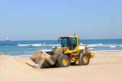 bulldozer working on a beach