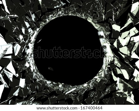 Bullet hole and pieces of shattered glass on black