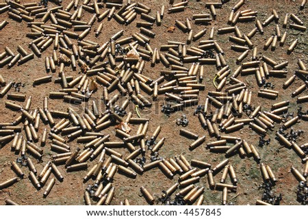 bullet shells scattered on the ground