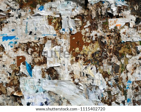 bulletin board with broken old ads and ads #1115402720
