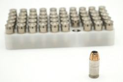 Bullets and ammunition close ups on a white background