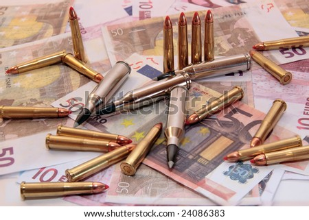bullets and money showing a dangerous side to life