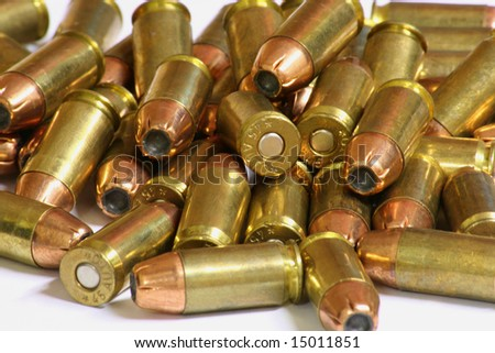 Bullets in a pile on a white background