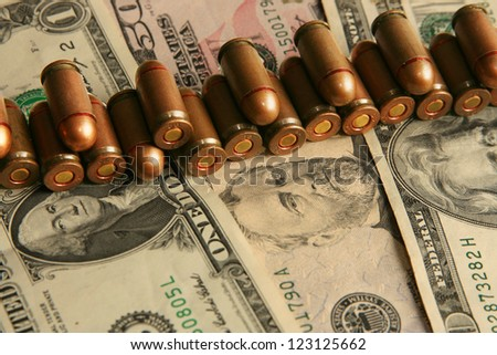 bullets on dollars background
