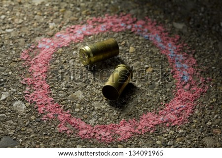Bullets on ground with chalk drawn around