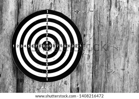 Bullseye is a target of business. Dart is an opportunity and Dartboard on old wood background. #1408216472