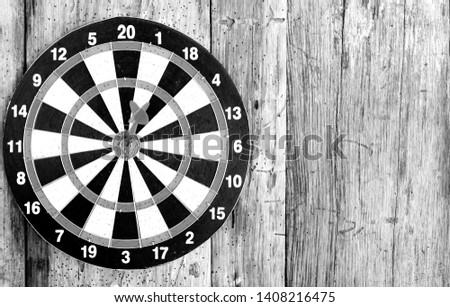 Bullseye is a target of business. Dart is an opportunity and Dartboard on old wood background. #1408216475