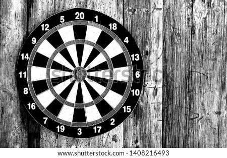 Bullseye is a target of business. Dart is an opportunity and Dartboard on old wood background. #1408216493