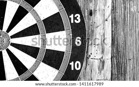Bullseye is a target of business. Dart is an opportunity and Dartboard on old wood background. #1411617989