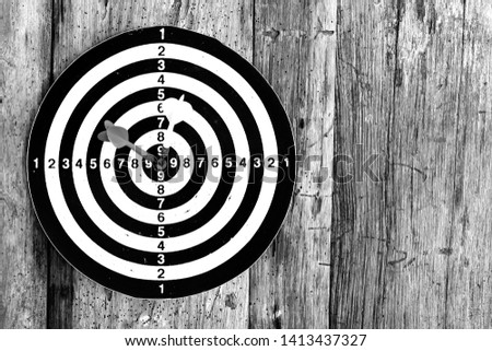 Bullseye is a target of business. Dart is an opportunity and Dartboard on old wood background. #1413437327