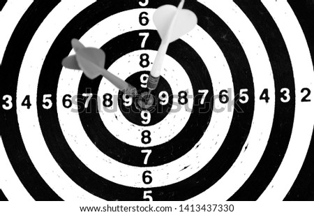 Bullseye is a target of business. Dart is an opportunity and Dartboard on old wood background. #1413437330