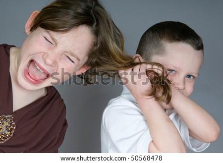 Bully boy pulling girl's hair