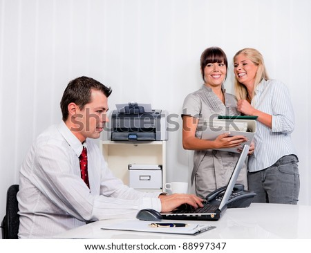 bullying in the workplace an office. women are talking about colleagues